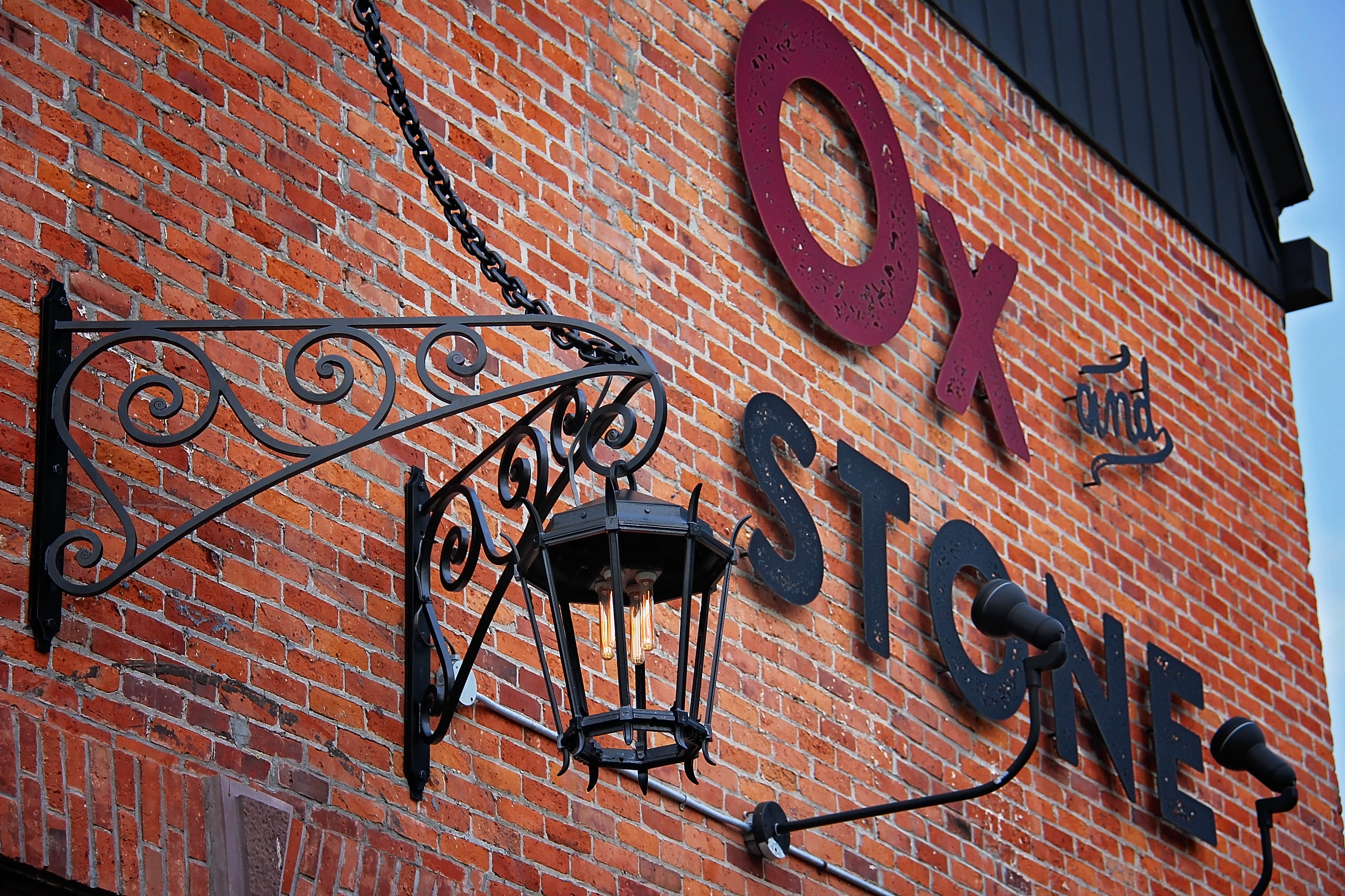 Ox and Stone Exterior Light and Signage